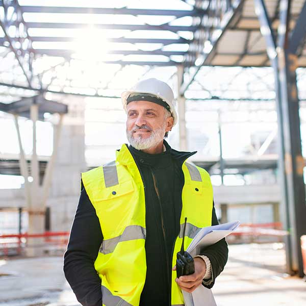 Construction engineer with walkie talkie DAS