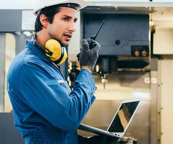 Factory engineer push to talk walkie talkie