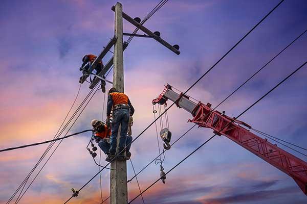 Power linemen crew restores communication lines
