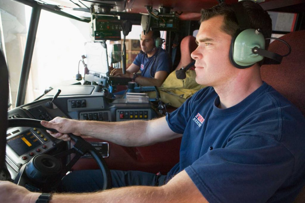 Two Firefighters Communicate on multiple frequency bands
