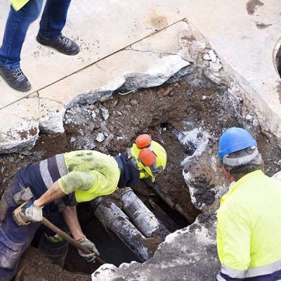 Government Utilities Company works on public road sewer lines