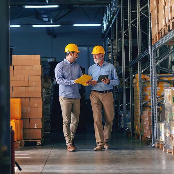 Manufacturing employees communicating